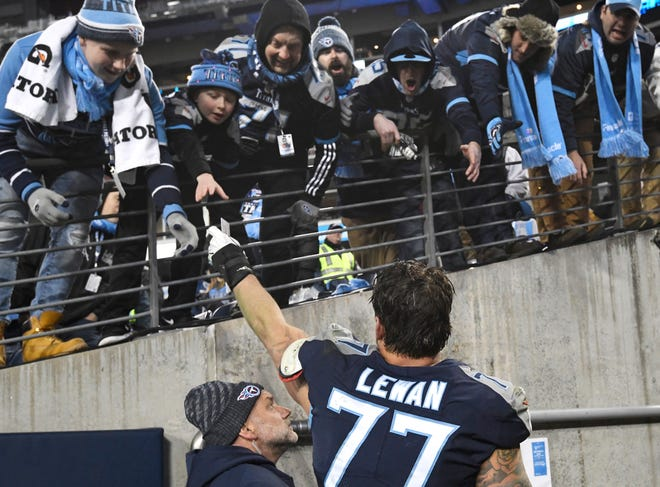 Titans offensive tackle Taylor Lewan (77) celebrates the win with fans at Nissan Stadium Thursday, Dec. 6, 2018, in Nashville, Tenn.