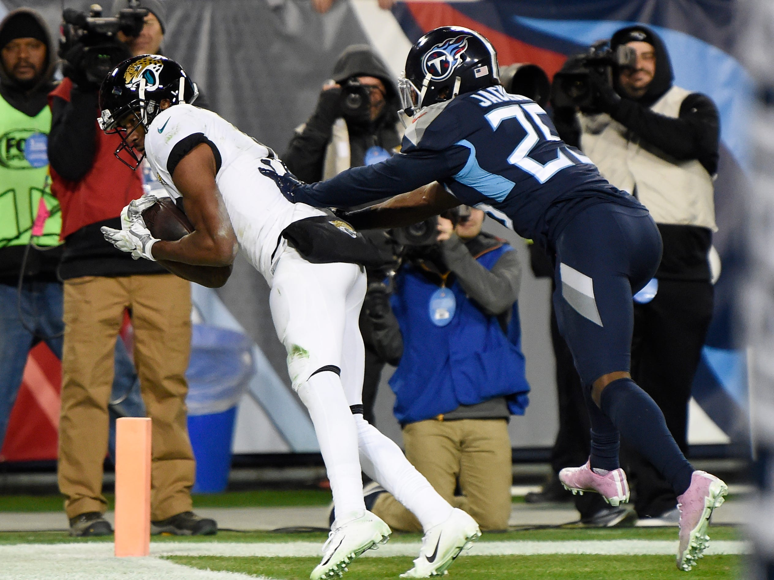 Jaguars wide receiver Dede Westbrook (12) gets into the end zone for a touchdown defended by Titans cornerback Adoree' Jackson (25) in the third quarter at Nissan Stadium Thursday, Dec. 6, 2018, in Nashville, Tenn.