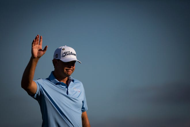 After a successful putt Patton Kizzire waves at the cheering crowd during the 30th annual QBE Shootout first round Friday.