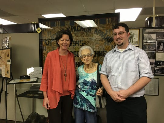 From left: Susan Suarez, president and CEO of the Holocaust museum, Lorie Mayer and Cody Rademacher, museum curator.