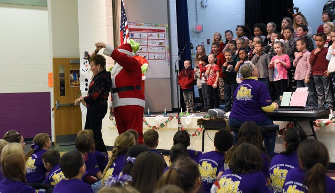 "Retired Carson Elementary teacher Judith Gorius and fifth grade teacher John Saxe dance to ""I Saw Mommy Kissing' Santa Claus"" during Carson Elementary's Christmas is Forever concert on Thursday, Dec. 6, 2018."
