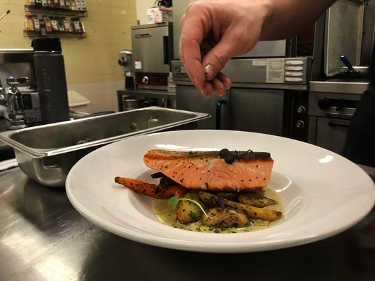Chef Goodwin makes a sample dish of one of the events of the day: King Salmon with herb roasted potatoes, baby carrots and walnut and arugula sauce.