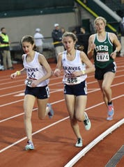 Corinne Barney (left) and twin sister Madeline running at the Oregon Relays.
