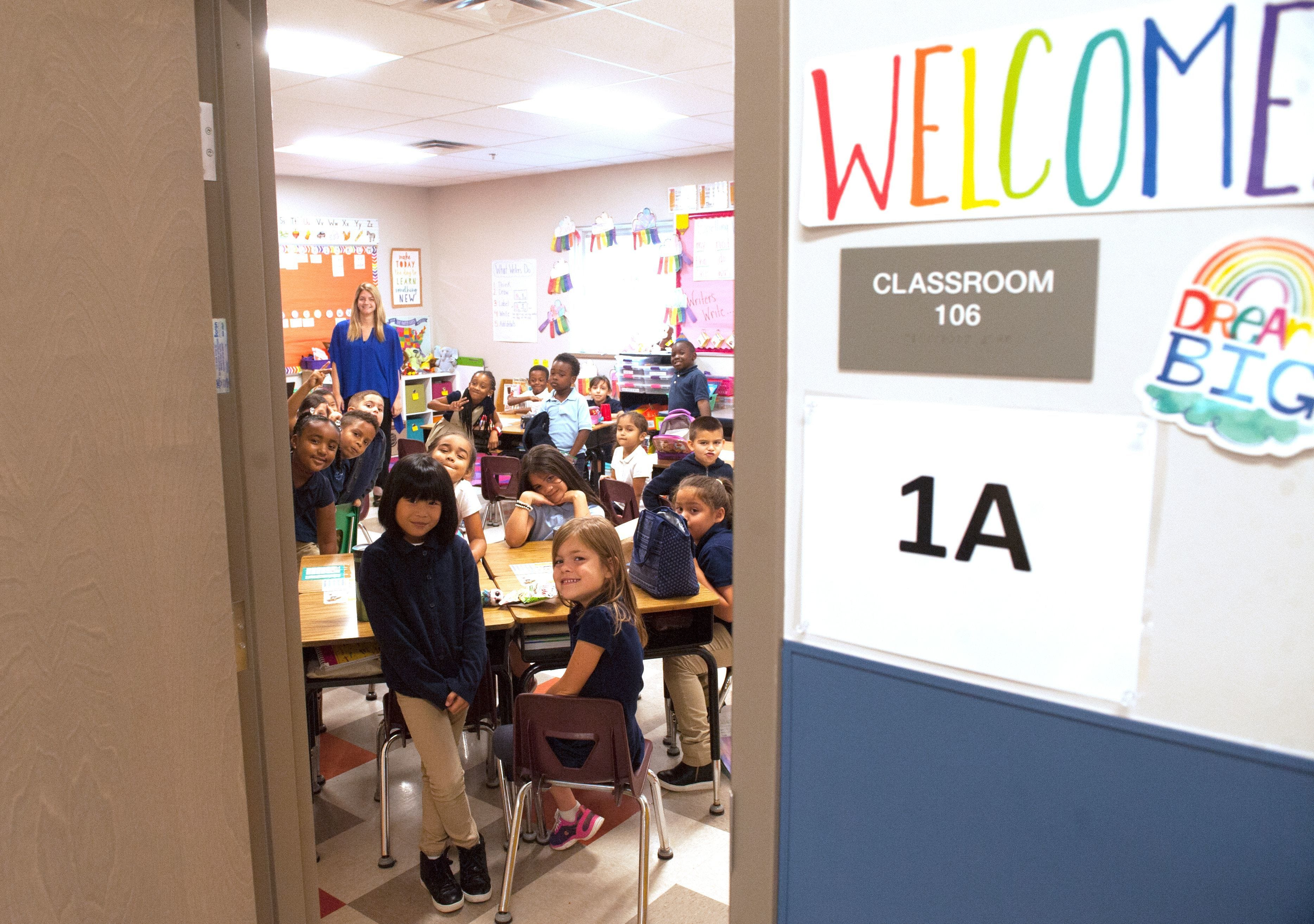 First-grade students posed for a photograph inside their classroom on Friday, Sept. 22, 2017,  minutes after a ribbon-cutting ceremony for the new Vineland Public Charter School.
