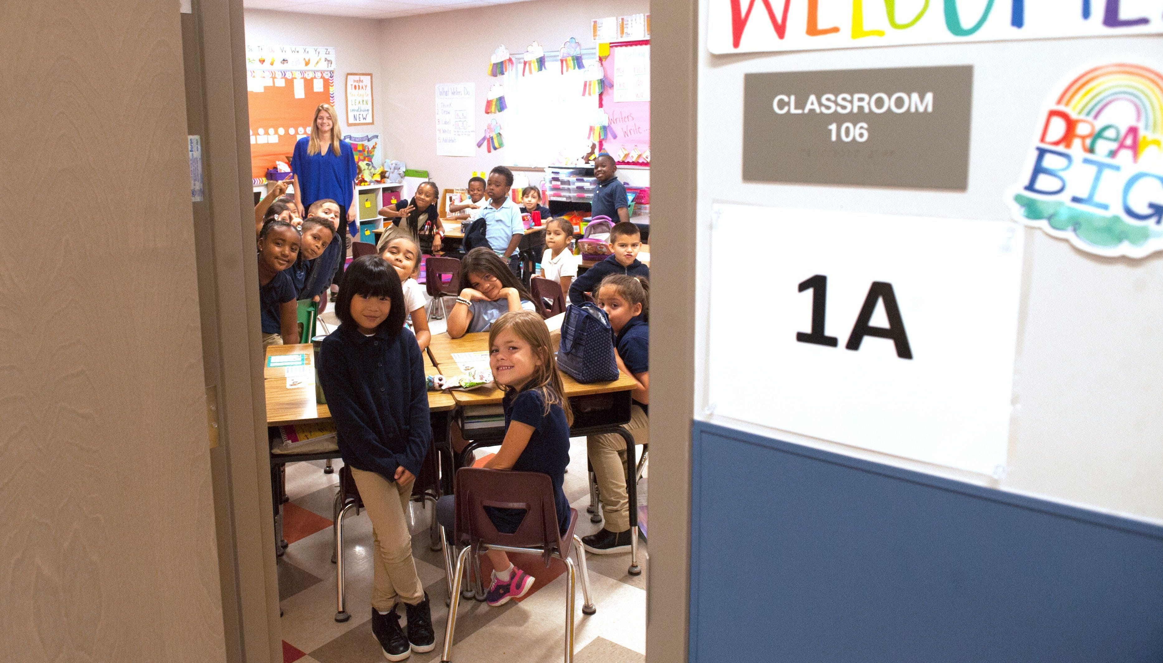 First-grade students pose for a photograph inside their classroom Friday at Vineland Public Charter School. First grade students posed for a photograph inside their classroom , Friday, Sept , 22, 2017,  minutes after the Ribbon Cutting Ceremony for the new Vineland Public Charter School, Vineland. N.J.