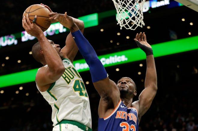 Boston Celtics center Al Horford (42) is defended by New York Knicks forward Noah Vonleh (32) during the second quarter of an NBA basketball game Thursday, Dec. 6, 2018, in Boston.