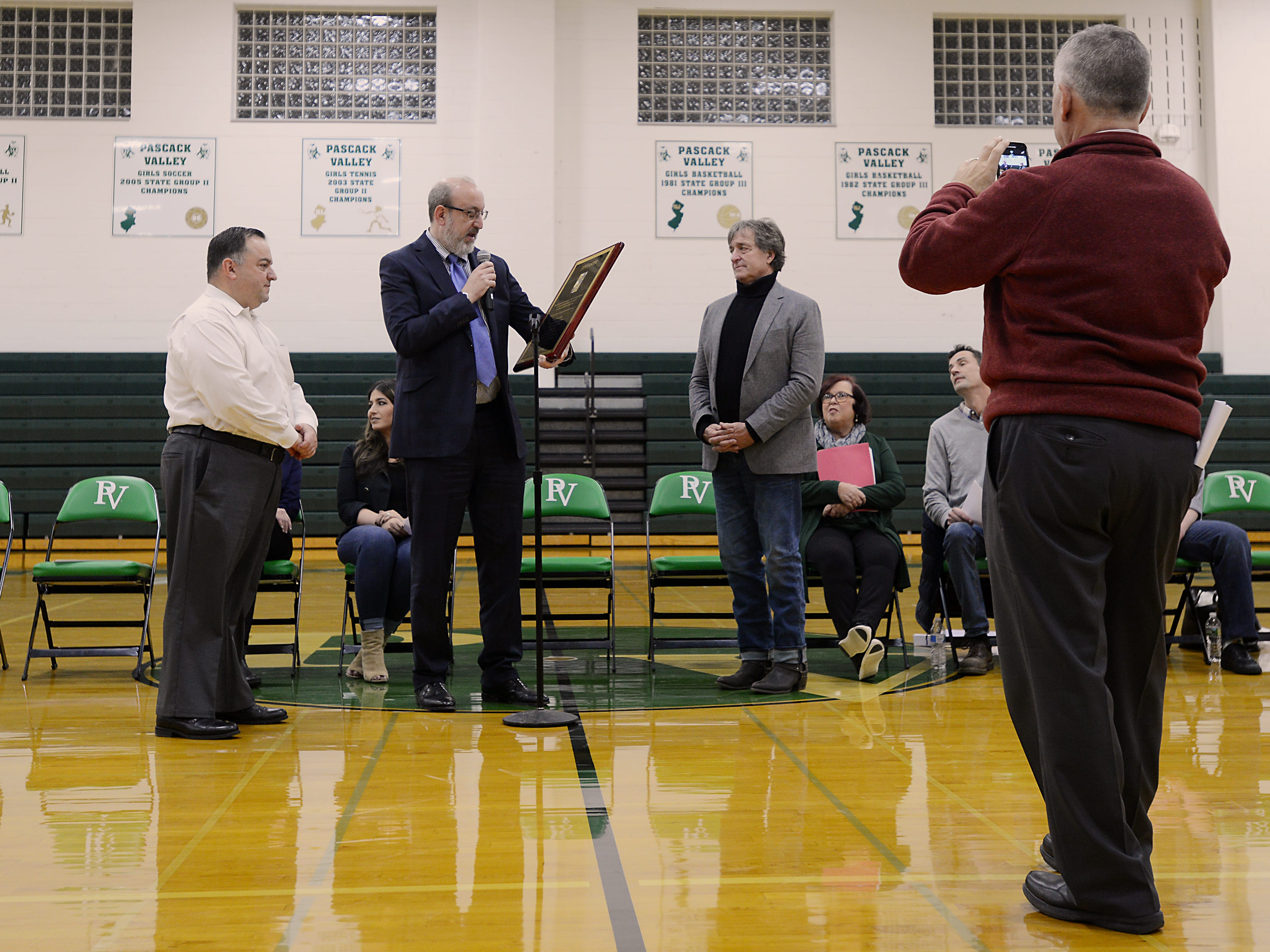 "Coach Jeff Jasper is honored with the naming of the PV Basketball Court ""Jasper Court"" in Hillsdale  on Thursday December 6, 2018. Principal Thomas DeMaio takes a photo of the event."