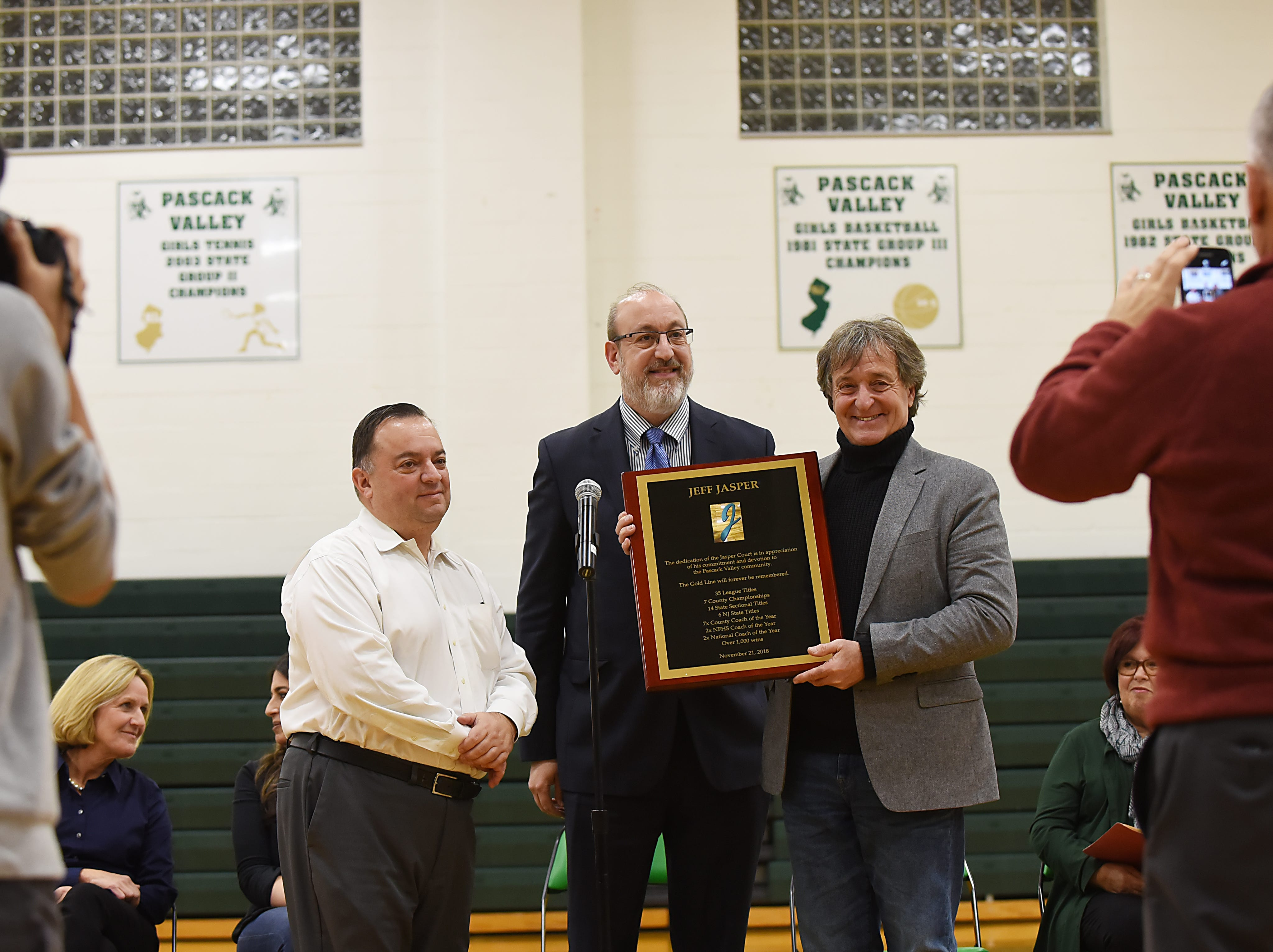 "Coach Jeff Jasper is honored with the naming of the PV Basketball Court ""Jasper Court"" in Hillsdale  on Thursday December 6, 2018. (From left) Joe Blundo, Jeffrey Steinfeld and Jeff Jasper."