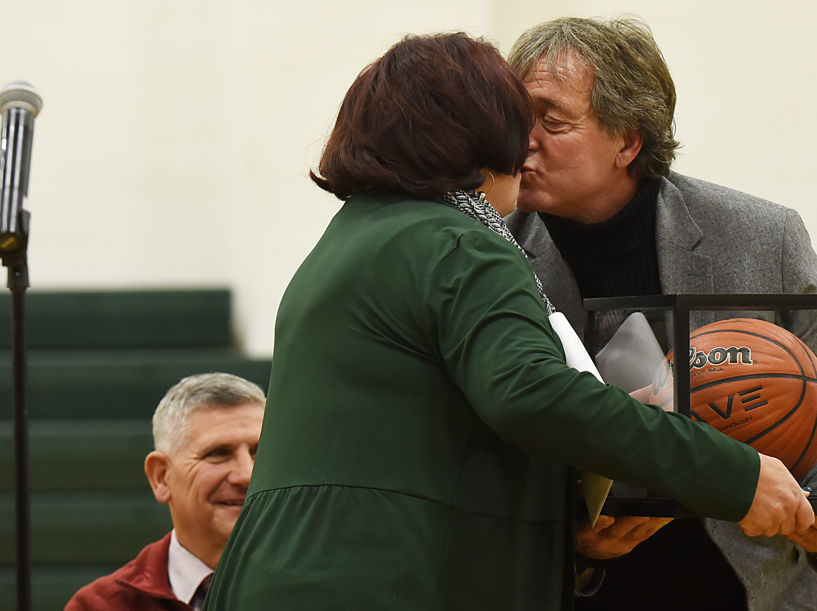 "Coach Jeff Jasper is honored with the naming of the PV Basketball Court ""Jasper Court"" in Hillsdale  on Thursday December 6, 2018. Jeff Jasper kisses his wife Lois Jasper during the ceremony."