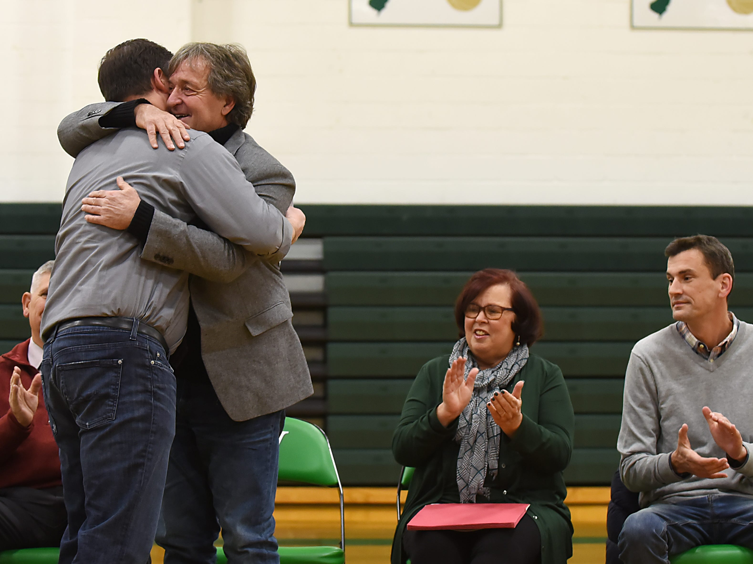 "Coach Jeff Jasper is honored with the naming of the PV Basketball Court ""Jasper Court"" in Hillsdale  on Thursday December 6, 2018. Jeff Jasper hugs his son Justin Jasper."