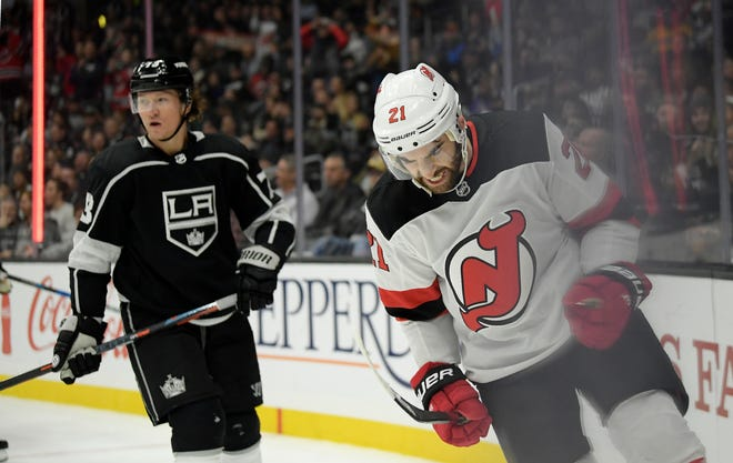 New Jersey Devils right wing Kyle Palmieri, right, celebrates his goal as Los Angeles Kings right wing Tyler Toffoli skates in the background during the first period of an NHL hockey game Thursday, Dec. 6, 2018, in Los Angeles.