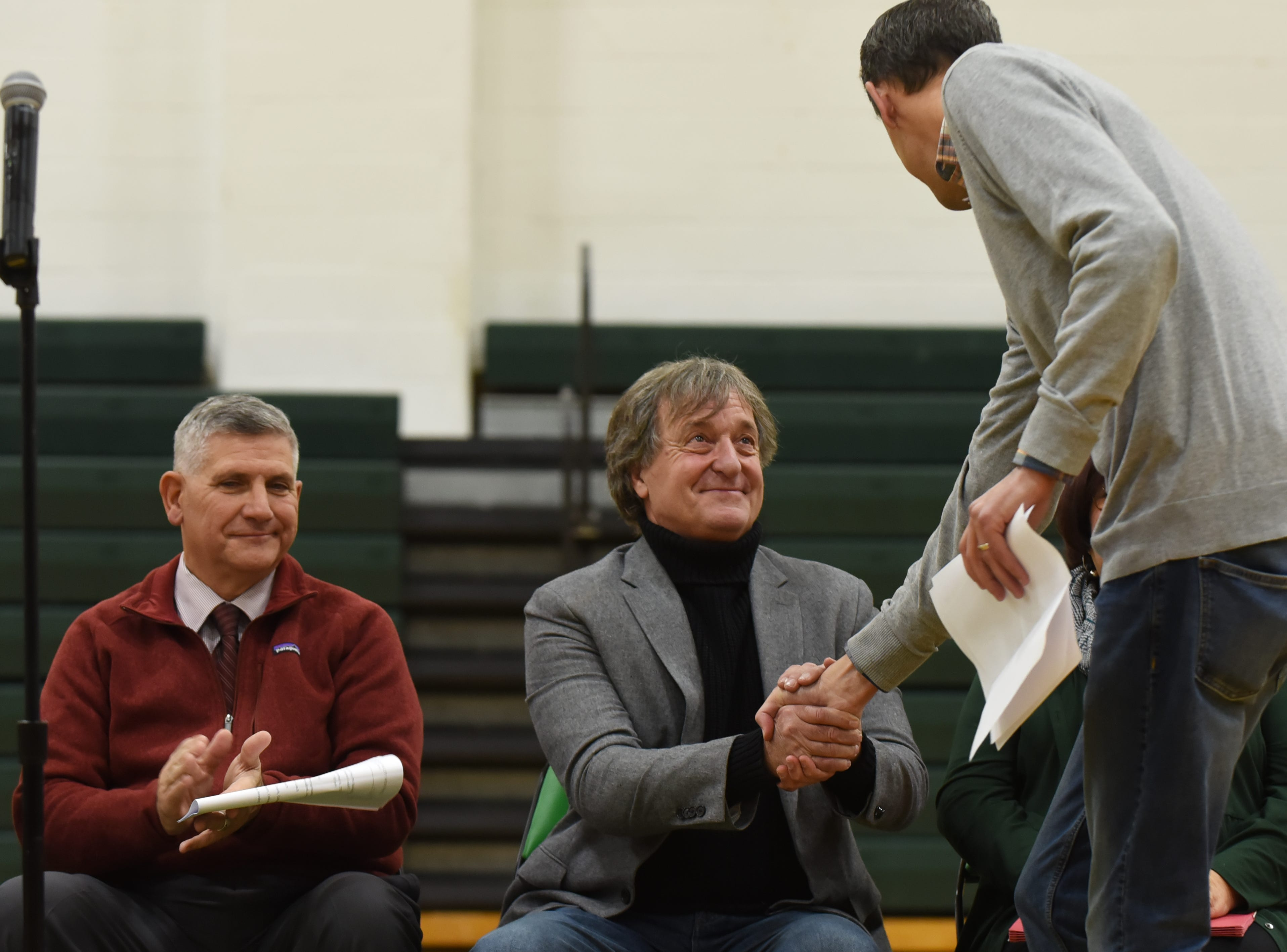 "Coach Jeff Jasper is honored with the naming of the PV Basketball Court ""Jasper Court"" in Hillsdale  on Thursday December 6, 2018. Jeff Jasper shakes Doug Goodman's hand after his speech."