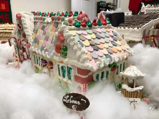 A collection of Riverdale resident Melissa Harsley's gingerbread candy houses on display at the Riverdale Public Library. Harsley teaches a popular program on constructing the houses every year at the library.