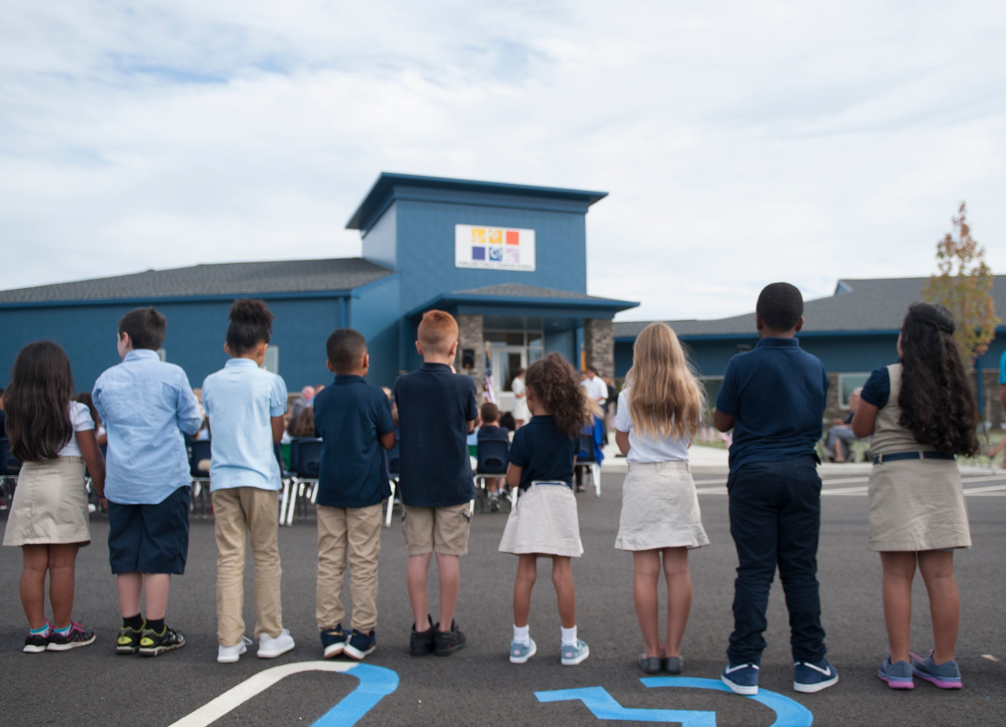 Children watch the ribbon-cutting ceremony for the new Vineland Public Charter School building in 2017.