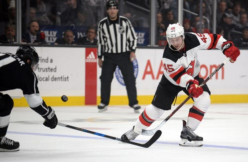 December 6, 2018; Los Angeles, CA, USA; New Jersey Devils defenseman Sami Vatanen (45) moves the puck against Los Angeles Kings center Anze Kopitar (11) during the first period at Staples Center.