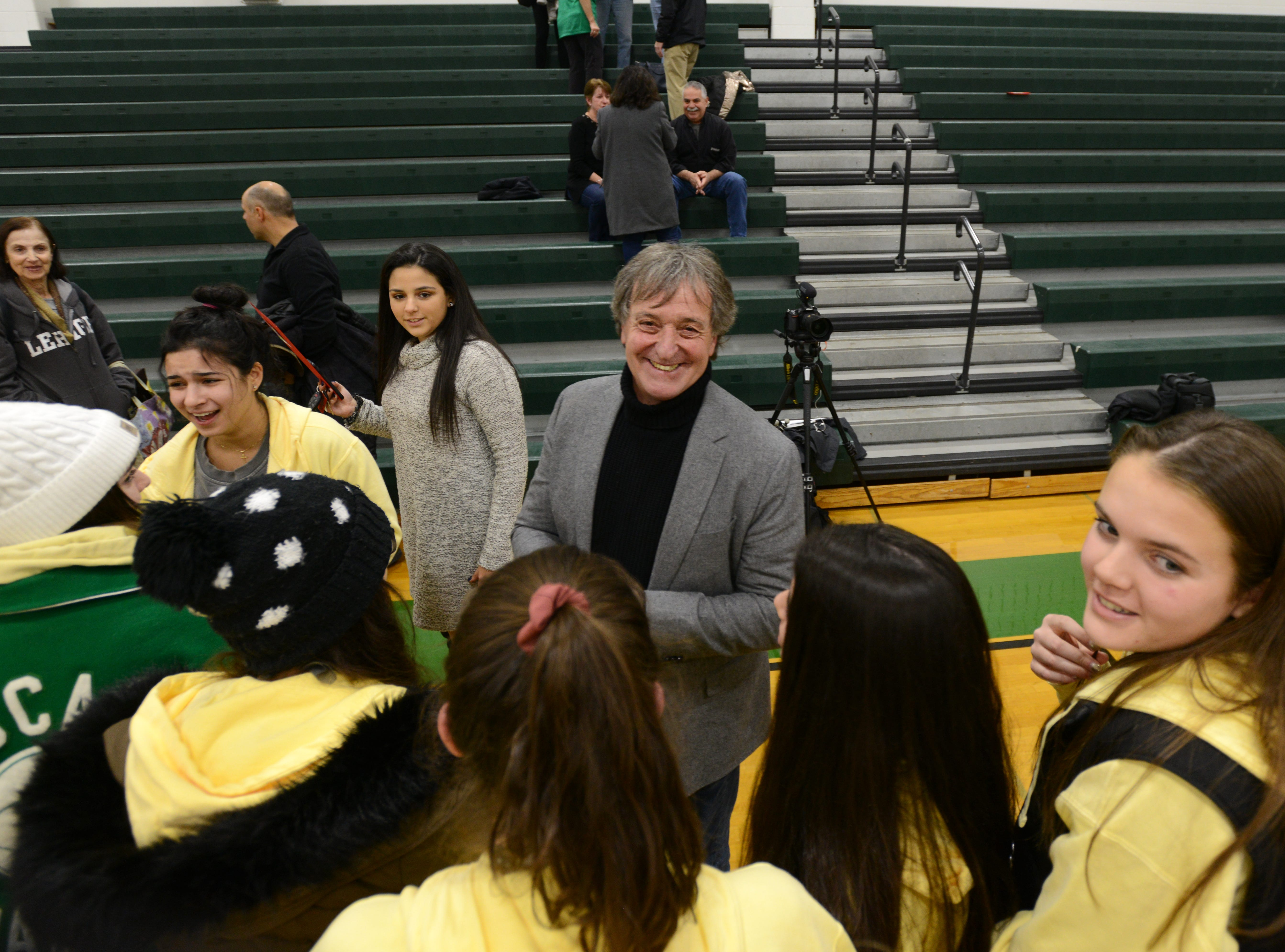 "Coach Jeff Jasper is honored with the naming of the PV Basketball Court ""Jasper Court"" in Hillsdale  on Thursday December 6, 2018. Jeff Jasper is surrounded by students during the event."
