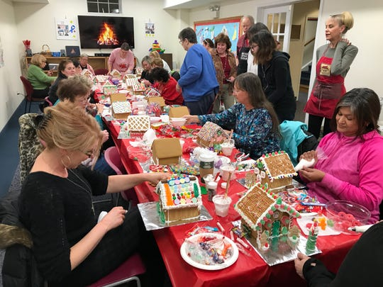 Riverdale residents construct gingerbread houses during a popular annual program taught by Melissa Harsley at the Riverdale Public Library.