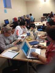 A group of teachers from Las Cruces Public Schools participate in a professional development workshop on the New Mexico State University campus as part of Math Snacks Early Algebra.