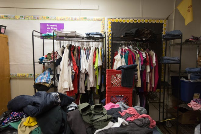 The clothing closet, set up in the community  room in Lynn Middle School, where families, students, teachers can all come and get clothing if they need along with some food. Wednesday, December 5, 2018.