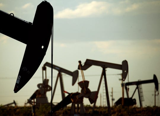In this April 24, 2015 file photo, pumpjacks work in a field near Lovington, N.M. With more barrels of oil being pumped monthly from the Permian Basin, New Mexico is among the nation's top producing states.