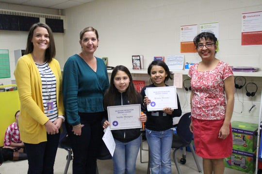From left to right, East Picacho Elementary Assistant Principal Nicole Bowen, Principal Nubia Tarazona, Saydie Marquez, Kristin Moreno, and teacher Gabriela Montes.
