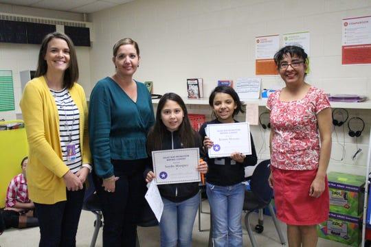 From left to right, East Picacho Elementary Assistant Principal Nicole Bowen, Principal Nubia Tarazona, Saydie Marquez, Kristin Moreno, and teacher Gabriela Montes.