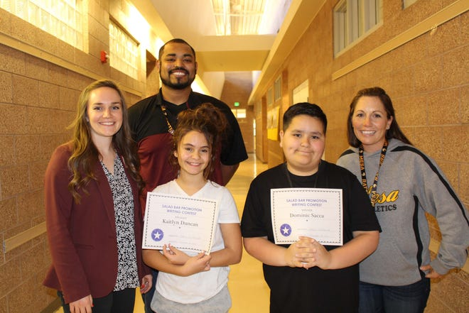 From left to right, Las Cruces Public Schools Nutrition Programs Manager Claire LeGault, Mesa Middle School student teacher Devon Valles, Kaitlyn Duncan, Dominic Sacca, and teacher Natalie Geiger.