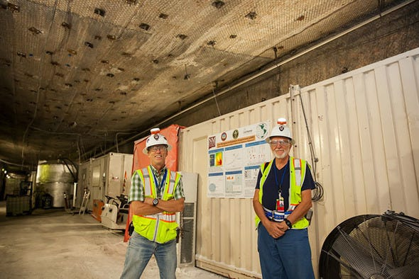 New Mexico State University biology professor Geoff Smith, left, and scientist Maurizio Tomasi worked underground at the Waste Isolation Pilot Plant this summer to study the effects of low-background radiation on a variety of organisms.