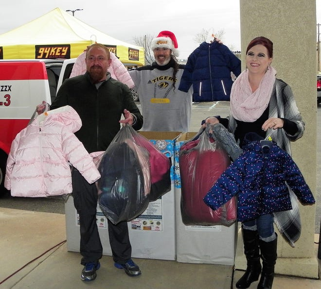 From left David Gonzalez of Tularosa Basin Telephone Company, Mike Mason of Burt Broadcasting/Tularosa Communications, Inc. and Tiffany Fuller of Tularosa Basin Telephone Company/Tularosa Communications, Inc. show off donated coats for Thrive's Koats for Kids coat donation drive at First National Bank Friday.