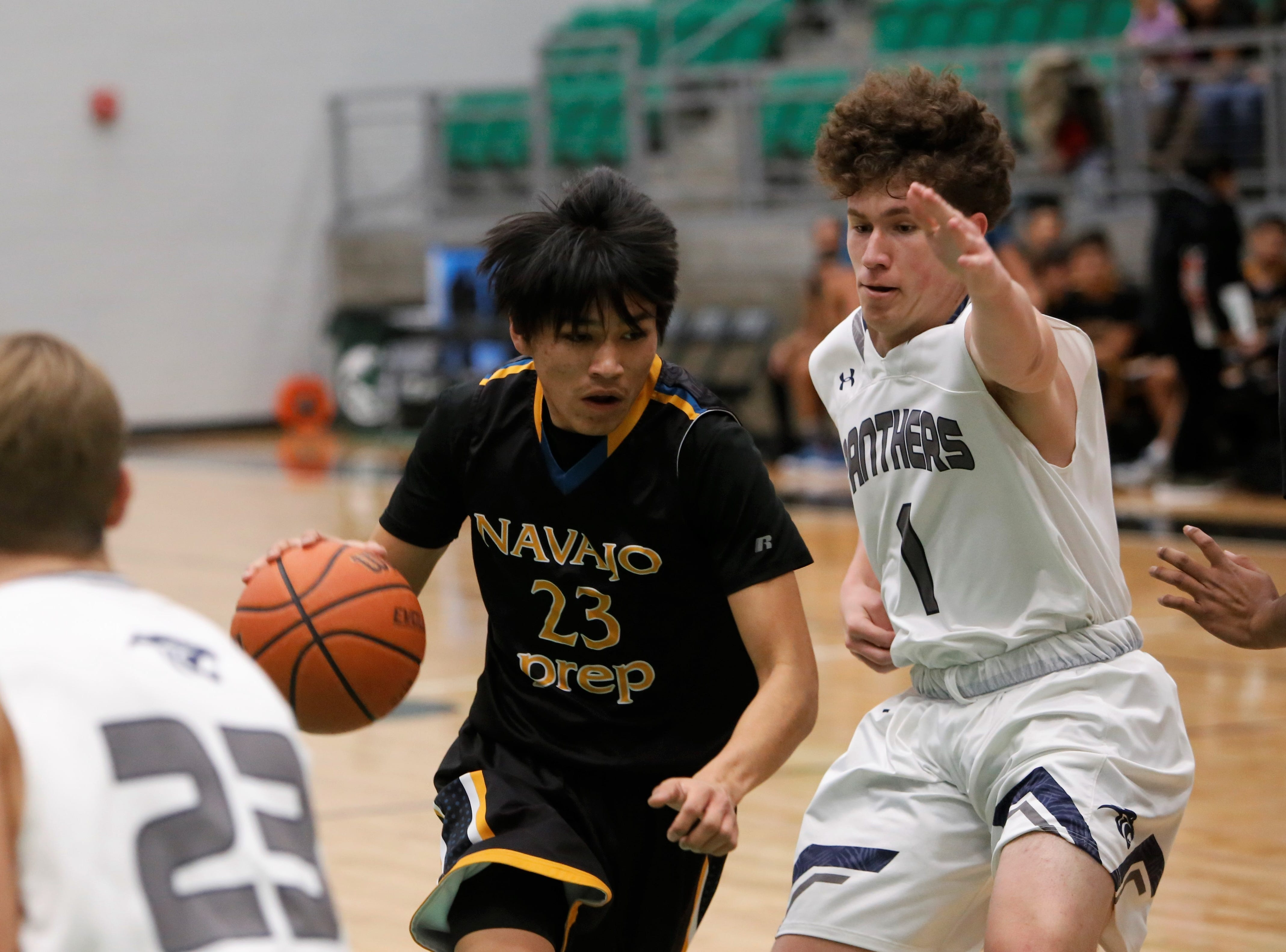 Navajo Prep's Trejan Clichee attacks the basket against Piedra Vista's Jalen Woods during the Marv Sanders Invitational quarterfinals Thursday at Scorpion Arena in Farmington.