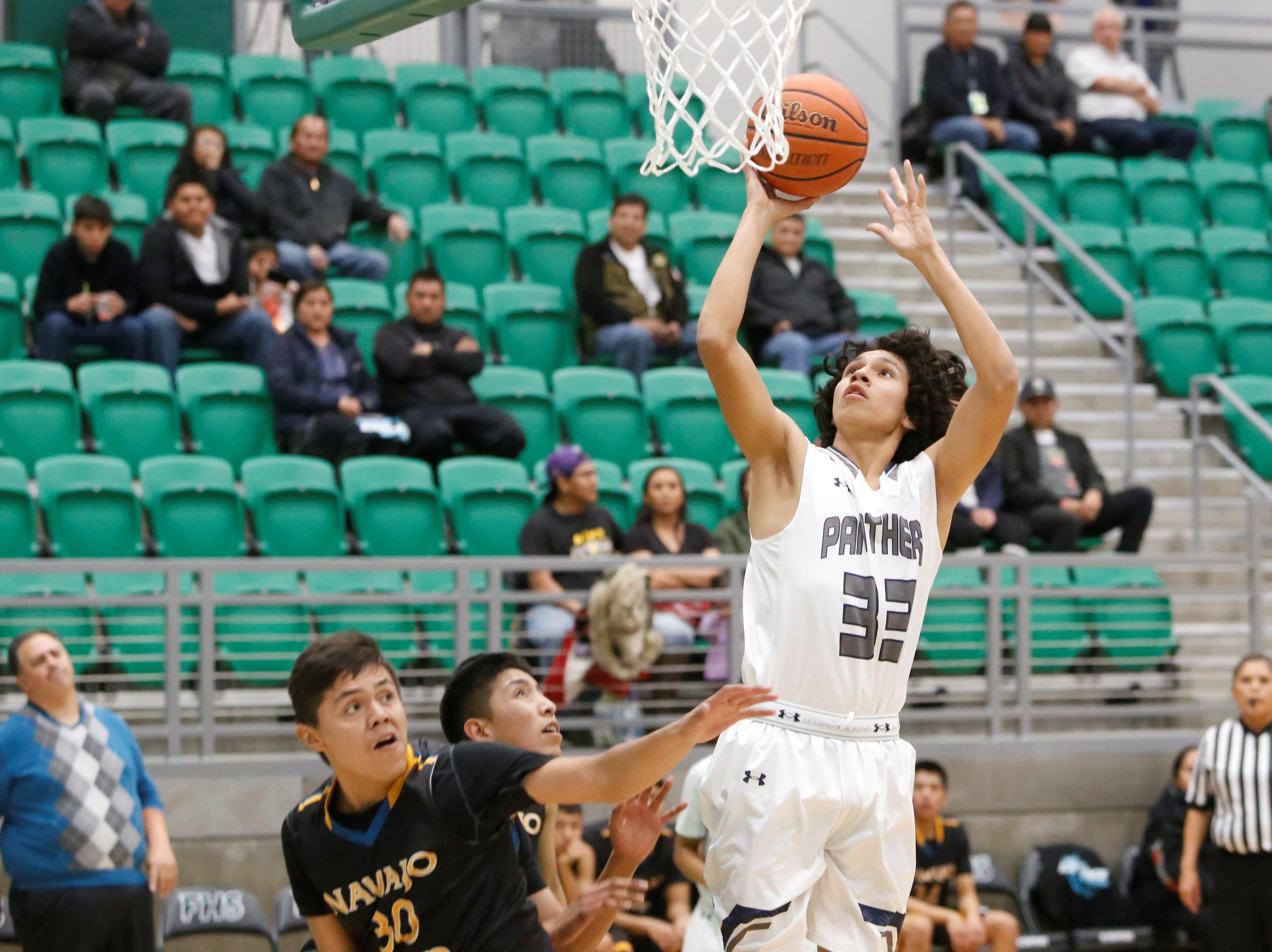Piedra Vista's Adam Johnson jumps up and makes a basket against Navajo Prep during the Marv Sanders Invitational quarterfinals Thursday at Scorpion Arena in Farmington.
