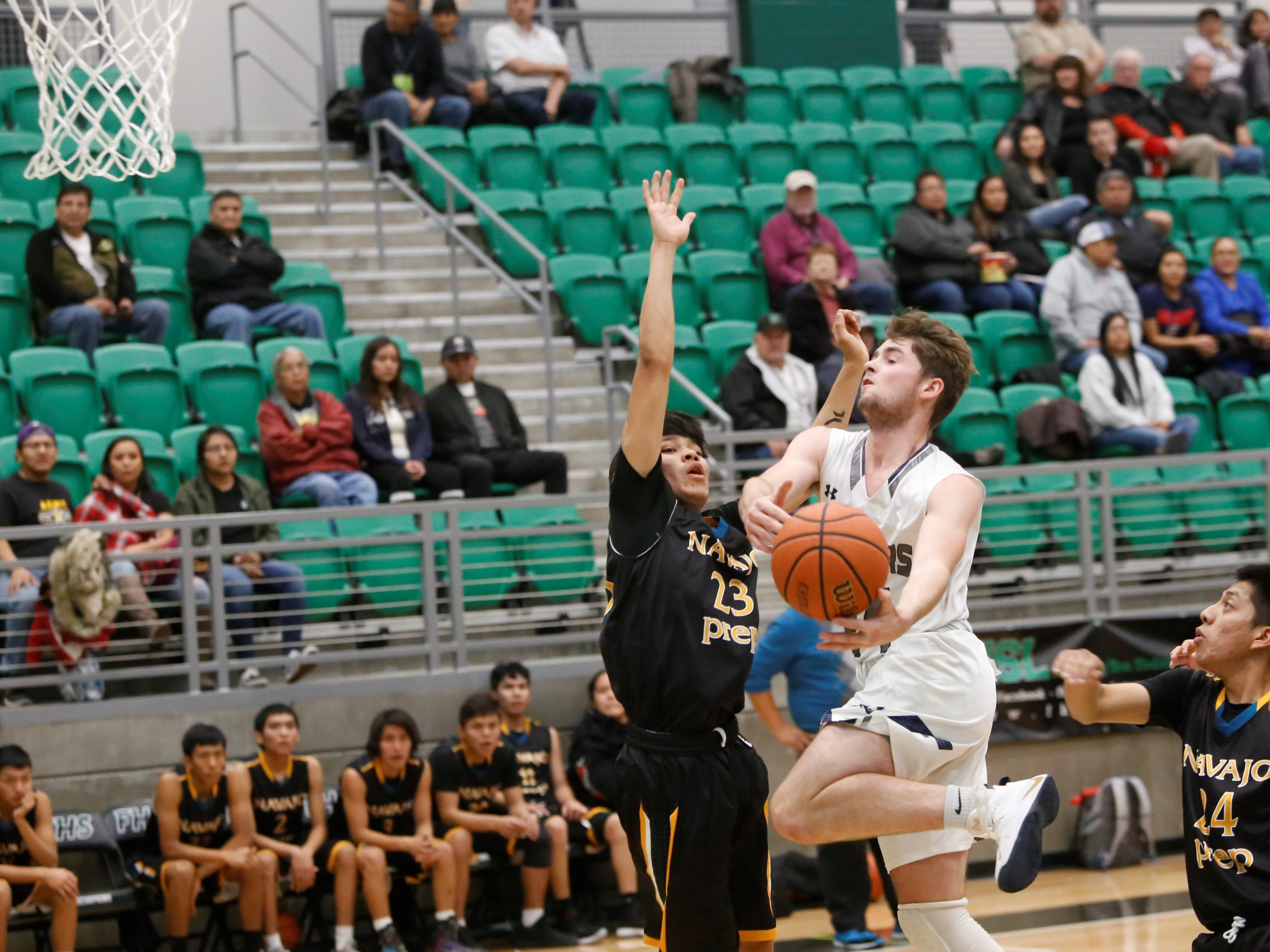 Piedra Vista's Lake Houston attacks the basket against Navajo Prep's Trejan Clichee during the Marv Sanders Invitational quarterfinals Thursday at Scorpion Arena in Farmington.