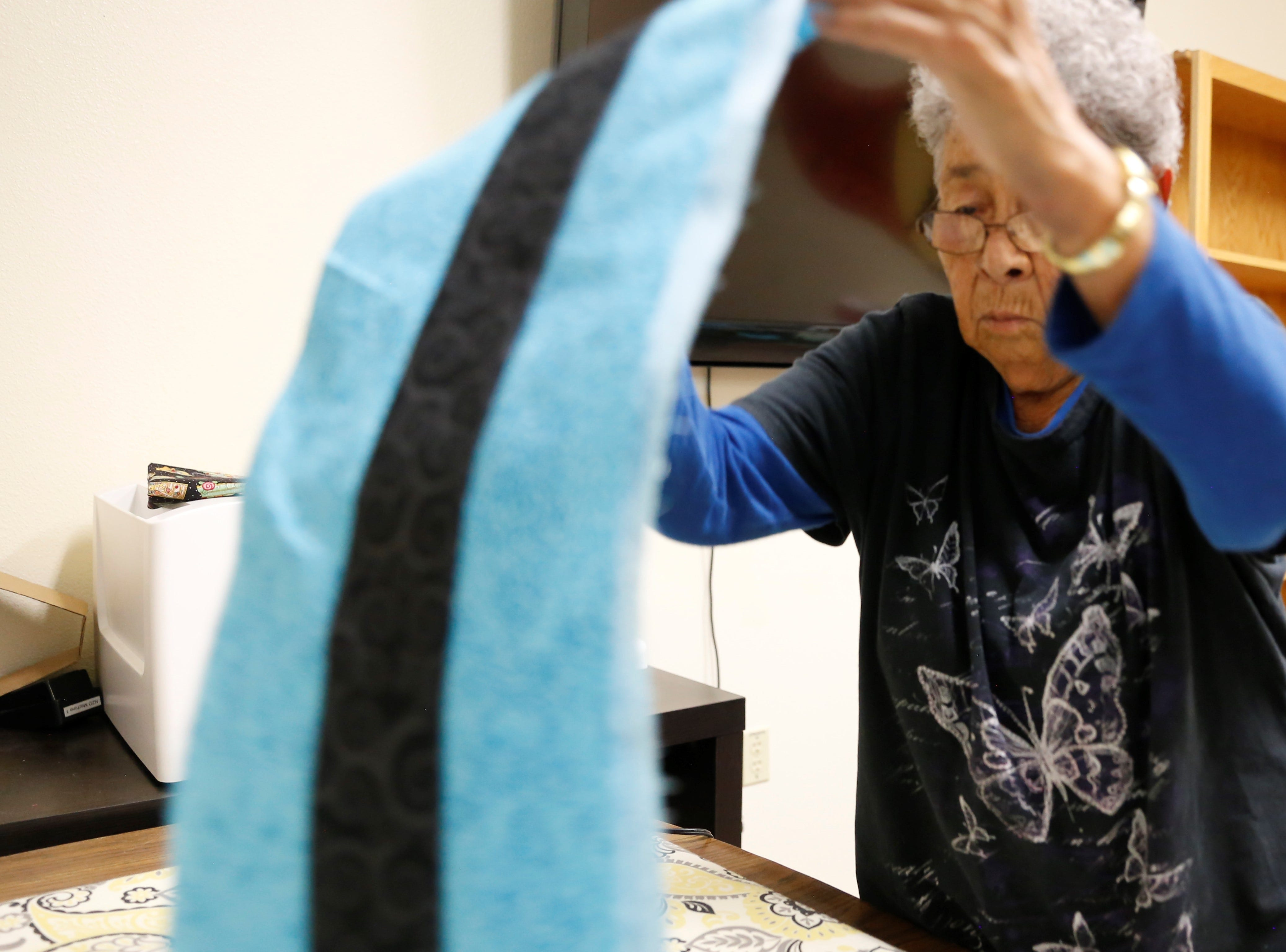 Alice Joe starts working on a twin-size quilt on Wednesday at the Nenahnezad Chapter house.