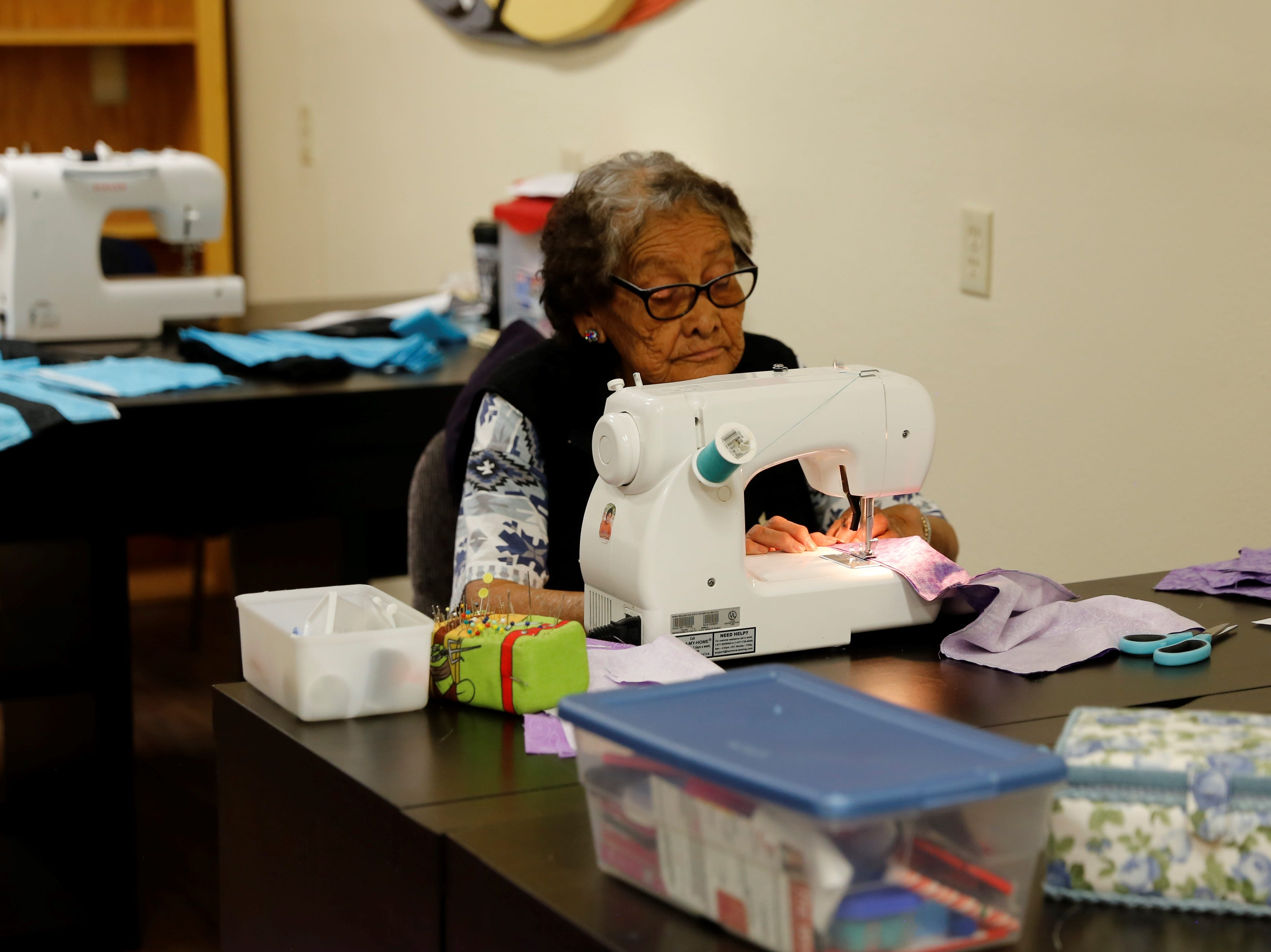 Abbie Allen sews a quilt on Wednesday at the Nenahnezad Chapter house.