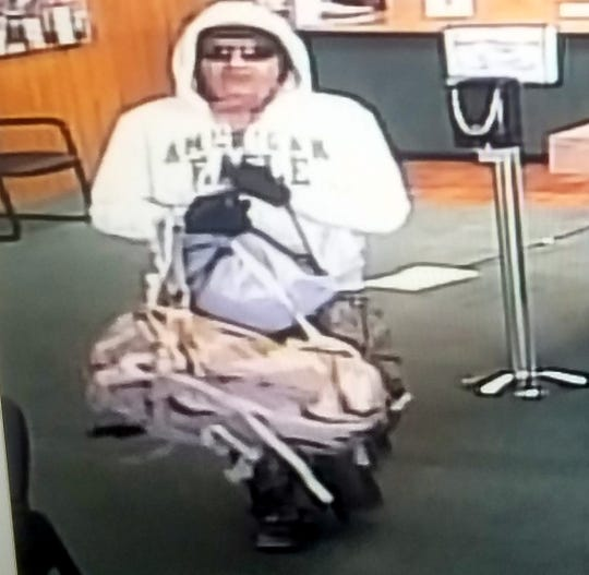 A full view of the robber was captured as he was leaving the bank.
