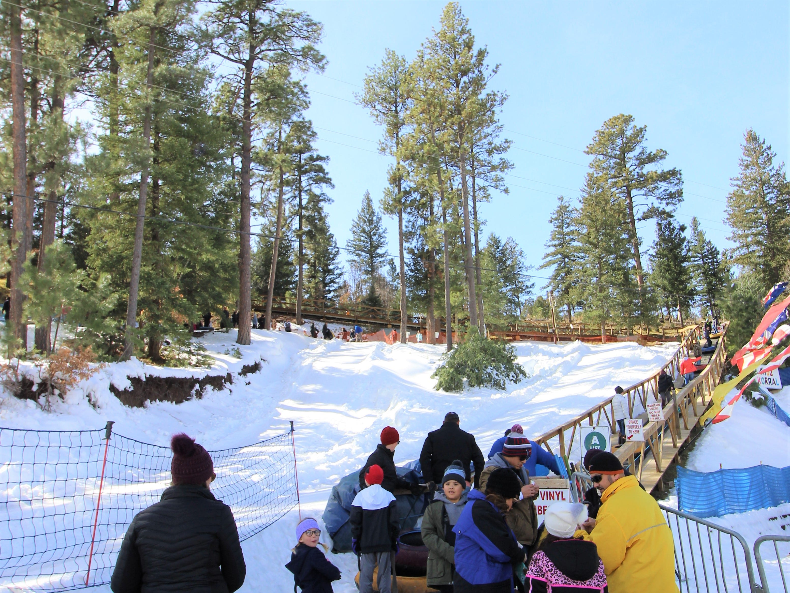 The lines may be long, but it do not stop any of these snow tubing enthusiasts from waiting for their turn to take a thrilling ride down the snow-covered hill.