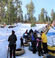 The lines may be long, but that did not stop any of these snow tubing enthusiasts.