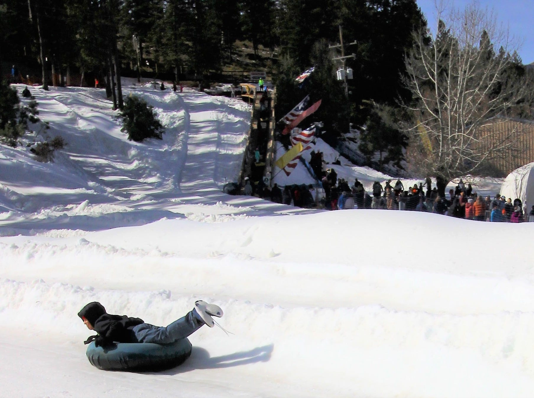 Swishing and twisting down the snowy slopes at Ruidoso Winter Park, this teen enjoys all the thrills of snow tubing.