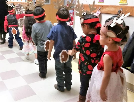 Pre-kindergarten pupils at Mescalero donned antlers and red noses for their parts in the annual production