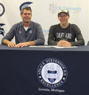On hand for Ben Rojewski's National Letter of Intent signing ceremony was Livonia Stevenson boys swim coach Jeff Shoemaker.