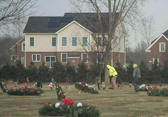 Knollwood workers prepare a plot for a burial.