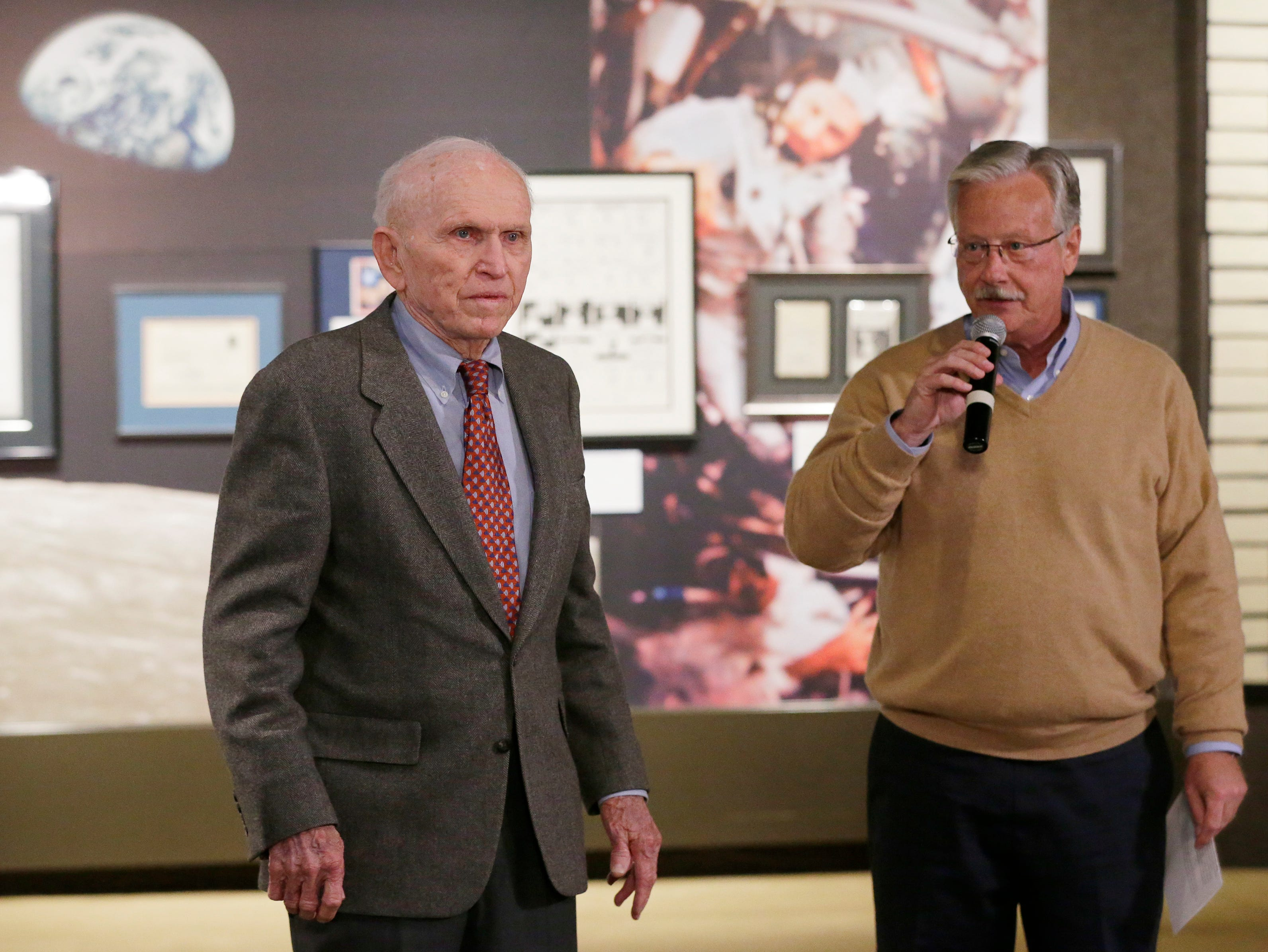 """Astronaut Frank Norman and EAA CEO/Chairman Jack Pelton talk before the opening of the exhibit.  The EAA Aviation Museum in Oshkosh, Wis. has opened """"The Borman Collection: An EAA Member's Space Odyssey,"""" an exhibit that features the personal archives and memorabilia of astronaut Frank Borman, who was on the leading edge of America's space program through the 1960s. The new exhibit was formally opened with a ribbon cutting by Borman on Friday, December 7, 2018.Joe Sienkiewicz/USA Today NETWORK-Wisconsin"""