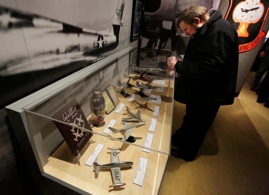 "William Hissem looks over some of the memorabilia in the exhibit.  The EAA Aviation Museum in Oshkosh, Wis. has opened ""The Borman Collection: An EAA Member's Space Odyssey,"" an exhibit that features the personal archives and memorabilia of astronaut Frank Borman, who was on the leading edge of America's space program through the 1960s. The new exhibit was formally opened with a ribbon cutting by Borman on Friday, December 7, 2018.