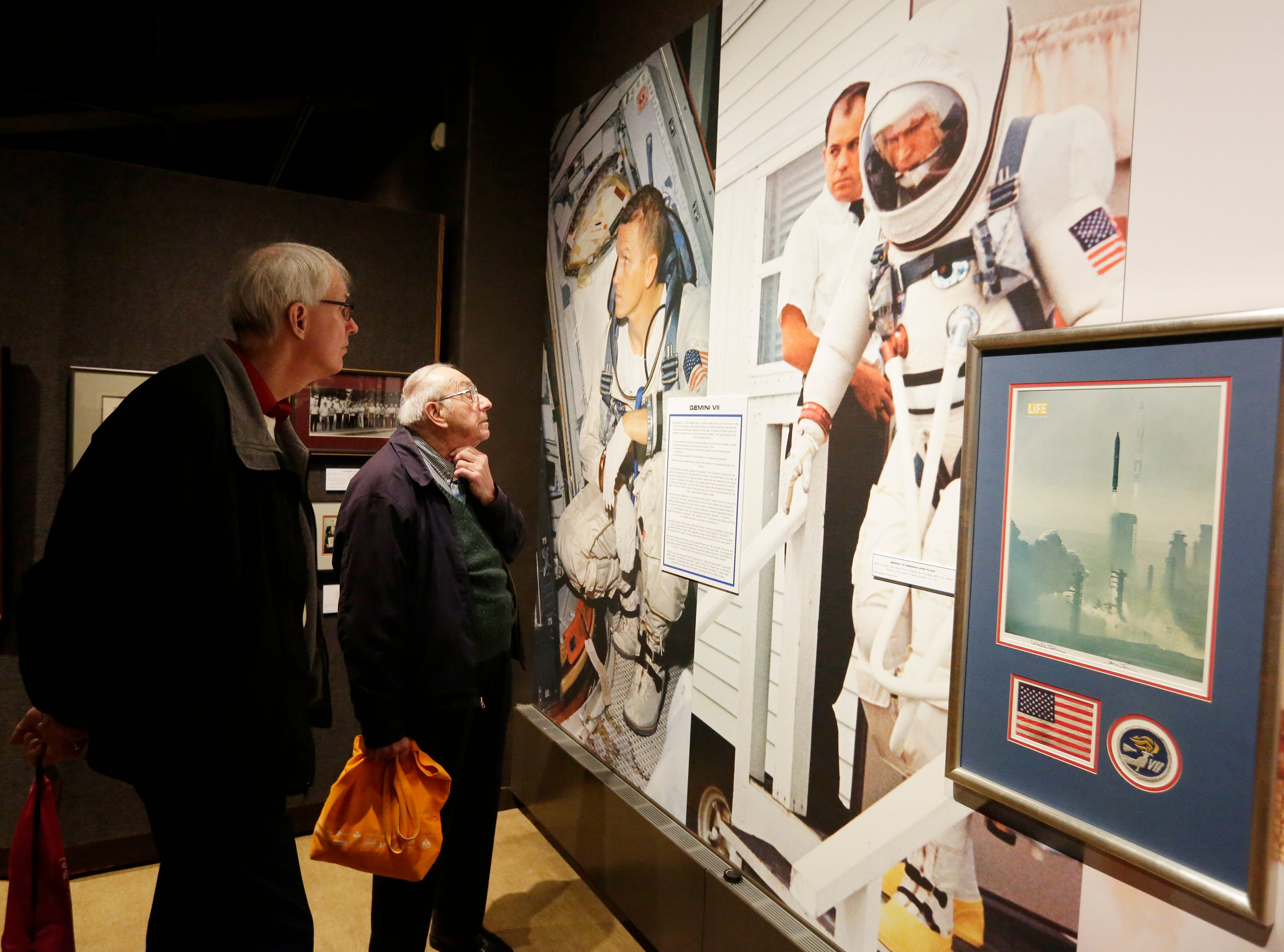 """Dale Rindfleisch and his son Dave Rindfleisch look over the exhibit.  The EAA Aviation Museum in Oshkosh, Wis. has opened """"The Borman Collection: An EAA Member's Space Odyssey,"""" an exhibit that features the personal archives and memorabilia of astronaut Frank Borman, who was on the leading edge of America's space program through the 1960s. The new exhibit was formally opened with a ribbon cutting by Borman on Friday, December 7, 2018.Joe Sienkiewicz/USA Today NETWORK-Wisconsin"""