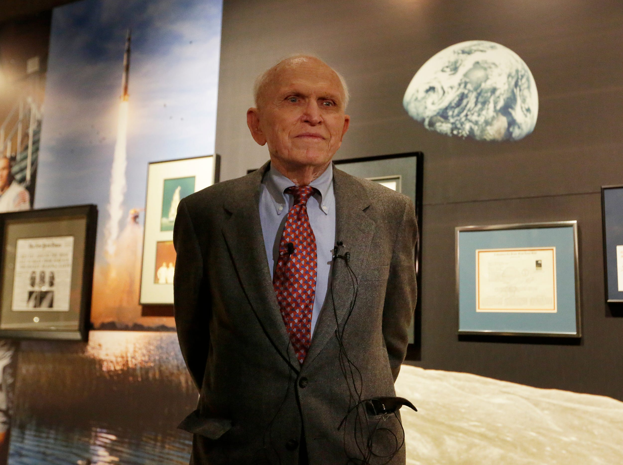 """Astronaut Frank Norman stands in front of his exhibit.  The EAA Aviation Museum in Oshkosh, Wis. has opened """"The Borman Collection: An EAA Member's Space Odyssey,"""" an exhibit that features the personal archives and memorabilia of astronaut Frank Borman, who was on the leading edge of America's space program through the 1960s. The new exhibit was formally opened with a ribbon cutting by Borman on Friday, December 7, 2018.Joe Sienkiewicz/USA Today NETWORK-Wisconsin"""