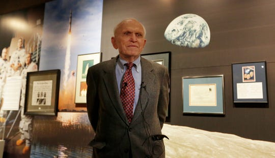 "Astronaut Frank Norman stands in front of his exhibit.  The EAA Aviation Museum in Oshkosh, Wis. has opened ""The Borman Collection: An EAA Member's Space Odyssey,"" an exhibit that features the personal archives and memorabilia of astronaut Frank Borman, who was on the leading edge of America's space program through the 1960s. The new exhibit was formally opened with a ribbon cutting by Borman on Friday, December 7, 2018.