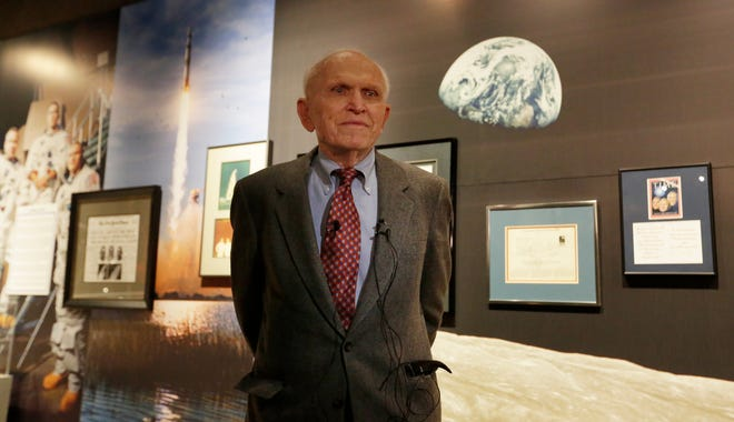 """Astronaut Frank Borman stands in front of his exhibit. The EAA Aviation Museum in Oshkosh, Wis. has opened """"The Borman Collection: An EAA Member's Space Odyssey,"""" an exhibit that features the personal archives and memorabilia of astronaut Frank Borman, who was on the leading edge of America's space program through the 1960s. The new exhibit was formally opened with a ribbon cutting by Borman on Friday, December 7, 2018. Joe Sienkiewicz/USA Today NETWORK-Wisconsin"""