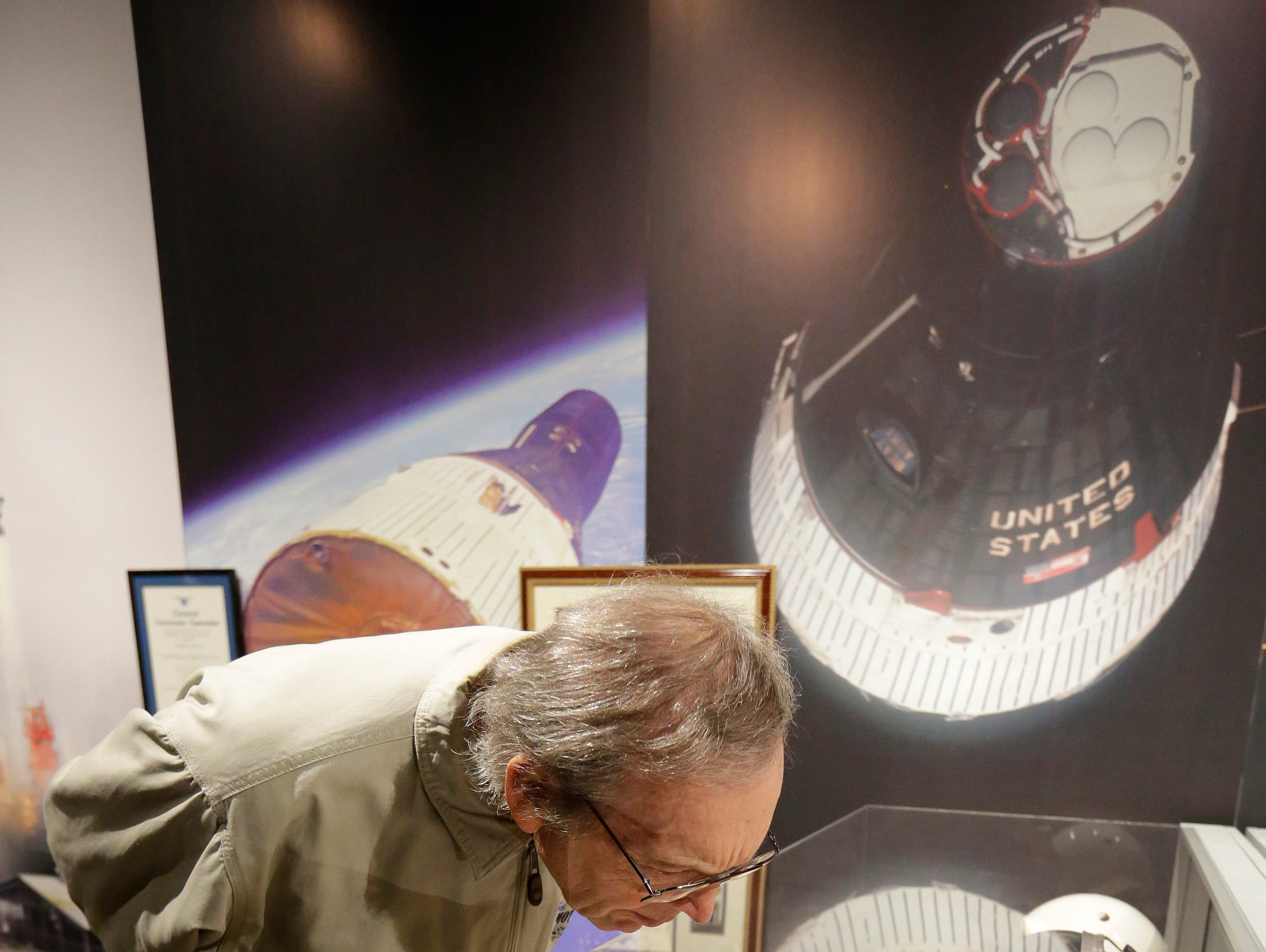 """Don Wokosin looks over some of the artifacts from the collection.  The EAA Aviation Museum in Oshkosh, Wis. has opened """"The Borman Collection: An EAA Member's Space Odyssey,"""" an exhibit that features the personal archives and memorabilia of astronaut Frank Borman, who was on the leading edge of America's space program through the 1960s. The new exhibit was formally opened with a ribbon cutting by Borman on Friday, December 7, 2018.Joe Sienkiewicz/USA Today NETWORK-Wisconsin"""