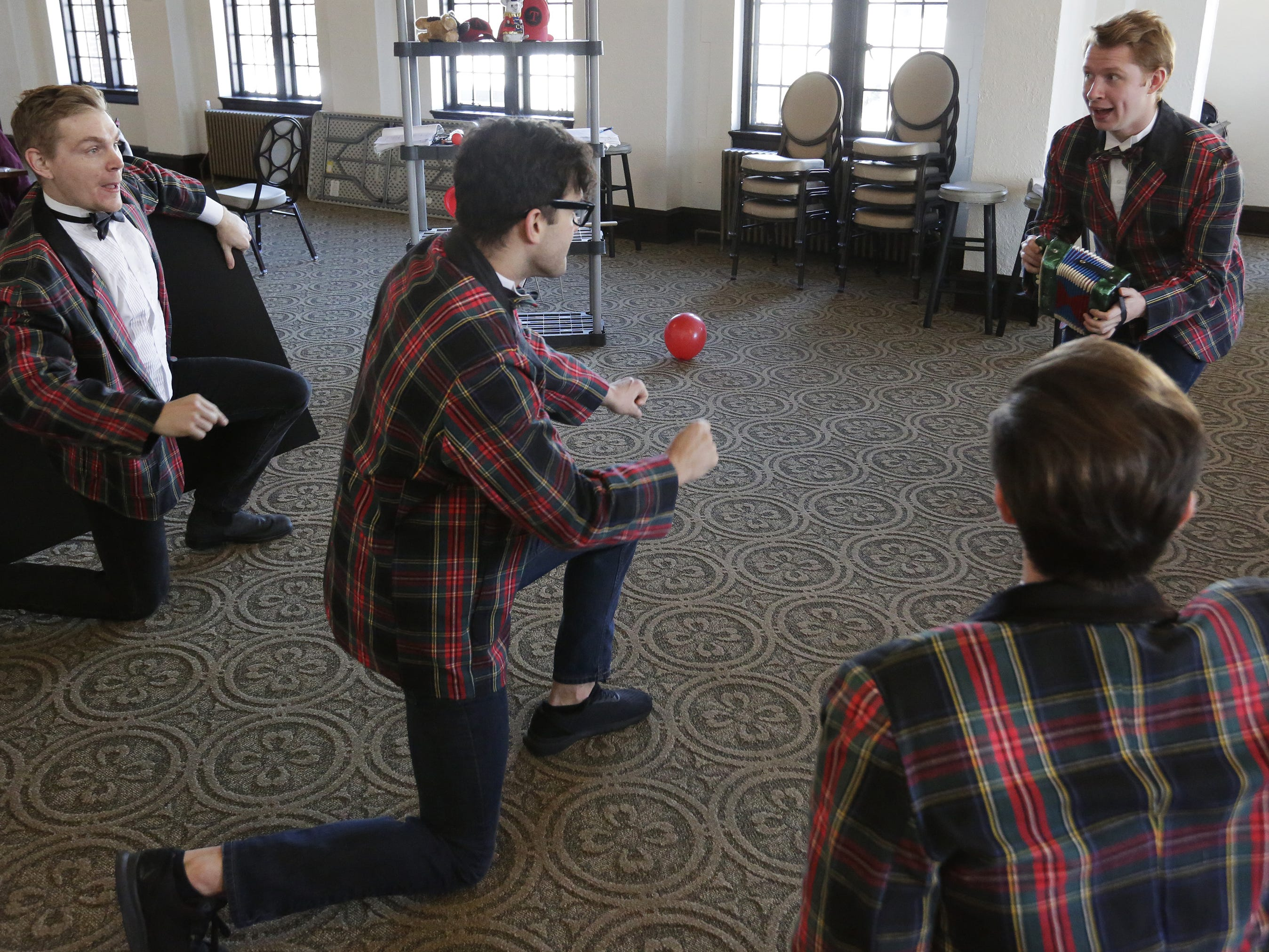 """Brian Krinsky, Bryce Dutton, Carver Duncan and Gabe Ford-Dunker rehearse Thursday, Dec. 6, 2018, for the dinner theater presentation """"Forever Plaid: Plaid Tidings,"""" which opens Dec. 13, 2018, at The Howard in Oshkosh."""