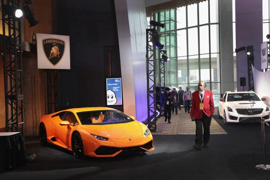 DETROIT, MI - JANUARY 14:  A Lamborghini (L) is displayed alongside other exotic cars outside the press center at the North American International Auto Show (NAIAS) on January 14, 2018 in Detroit, Michigan. The show is open to the public from January 20-28.  (Photo by Scott Olson/Getty Images)